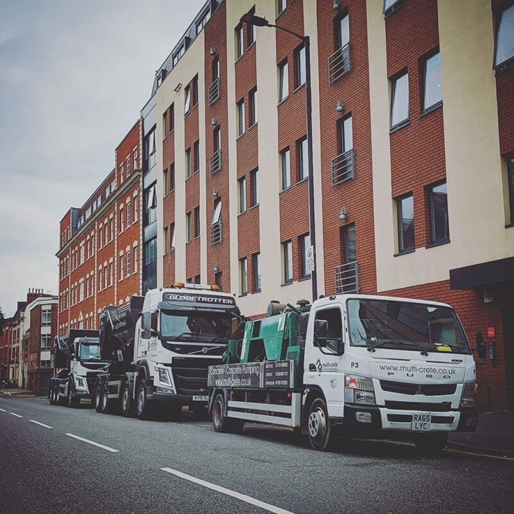Multi Crete Vans parked outside building